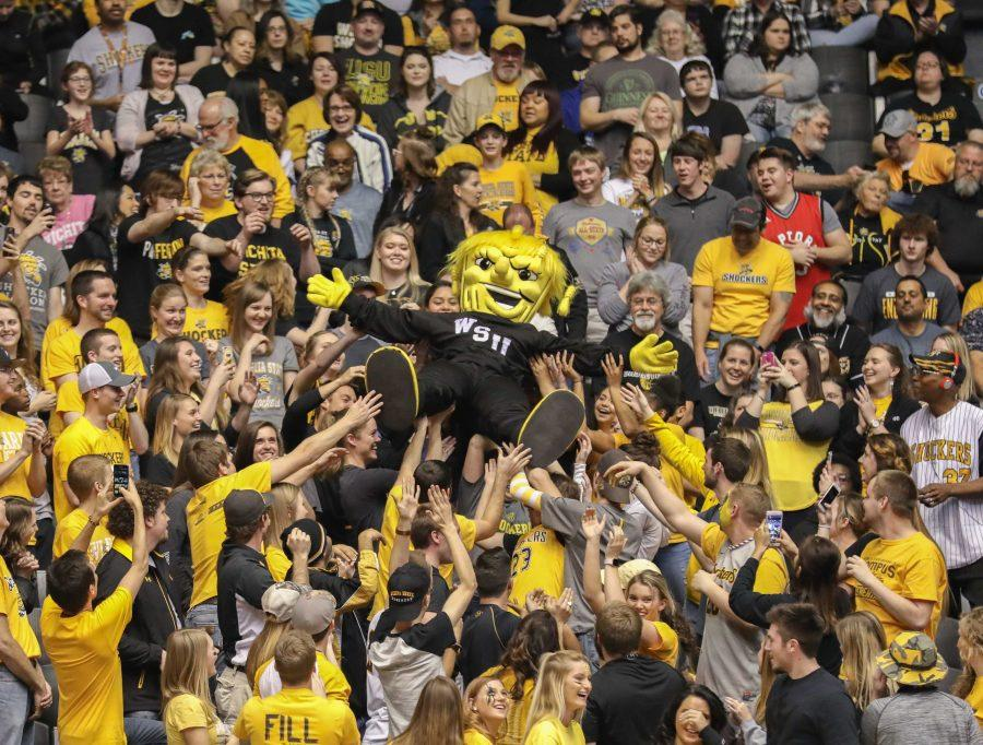WuShock crowd-surfs over the student section in the second half of the game against Evansville in Koch Arena. (Feb. 21, 2017)