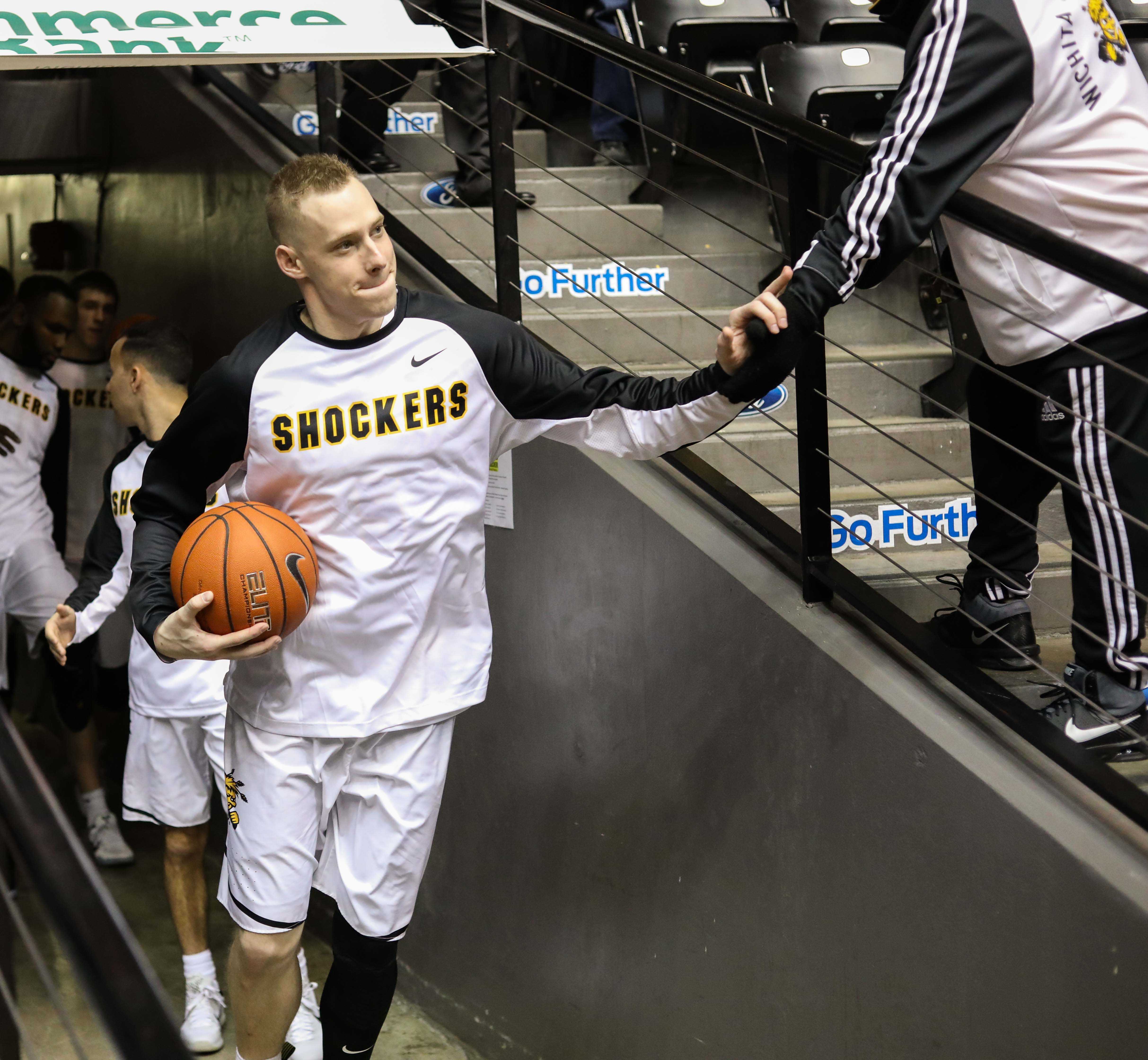 Wichita State guard Zach Bush (5) greets a fan as he leave the tunnel before Thursday's game. (Feb. 9, 2017)