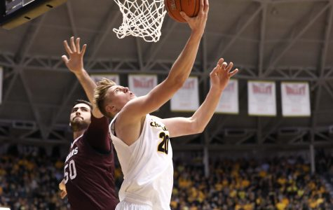 Wichita State Junior Rauno Nurger (20) twists around for a lay-up Thursday night against Missouri State. Nurger had 10 points for the Shockers in the 80-62 victory over the Bears. (Feb. 9, 2017)