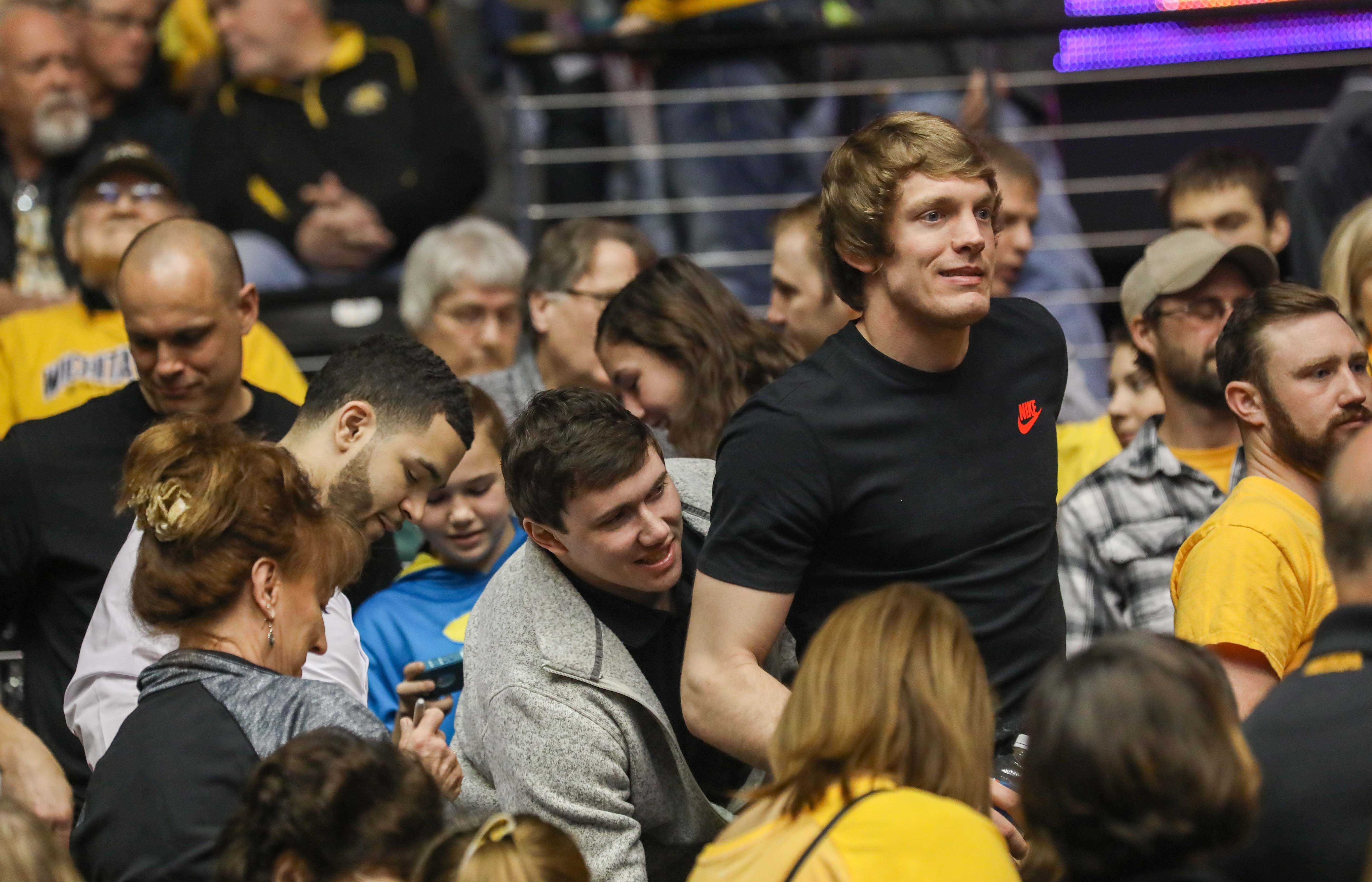 Former Wichita State players Ron Baker (right), Evan Wessel (center), and Fred Van Vleet (left) were in the stands for Wichita State's match-up against Northern Iowa. Baker and Van Vleet are currently playing in the NBA. (Feb. 18, 2017)