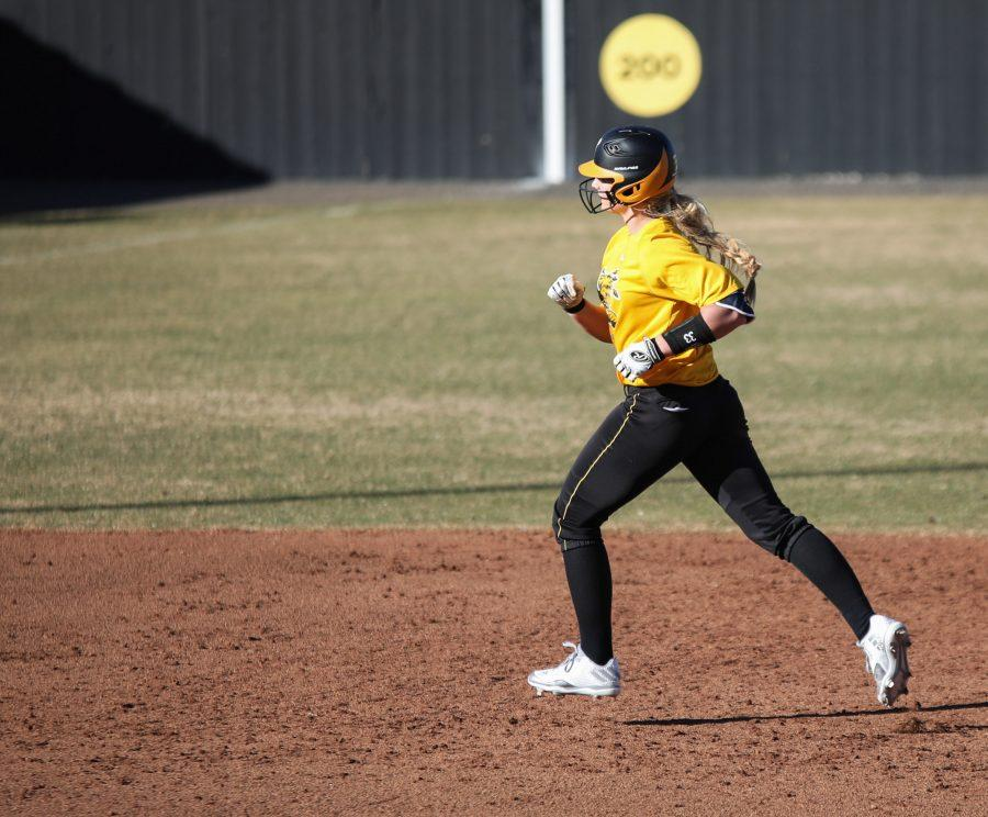 Ryleigh Buck rounds second base after hitting a home run in a scrimmage on Feb. 7, 2017.