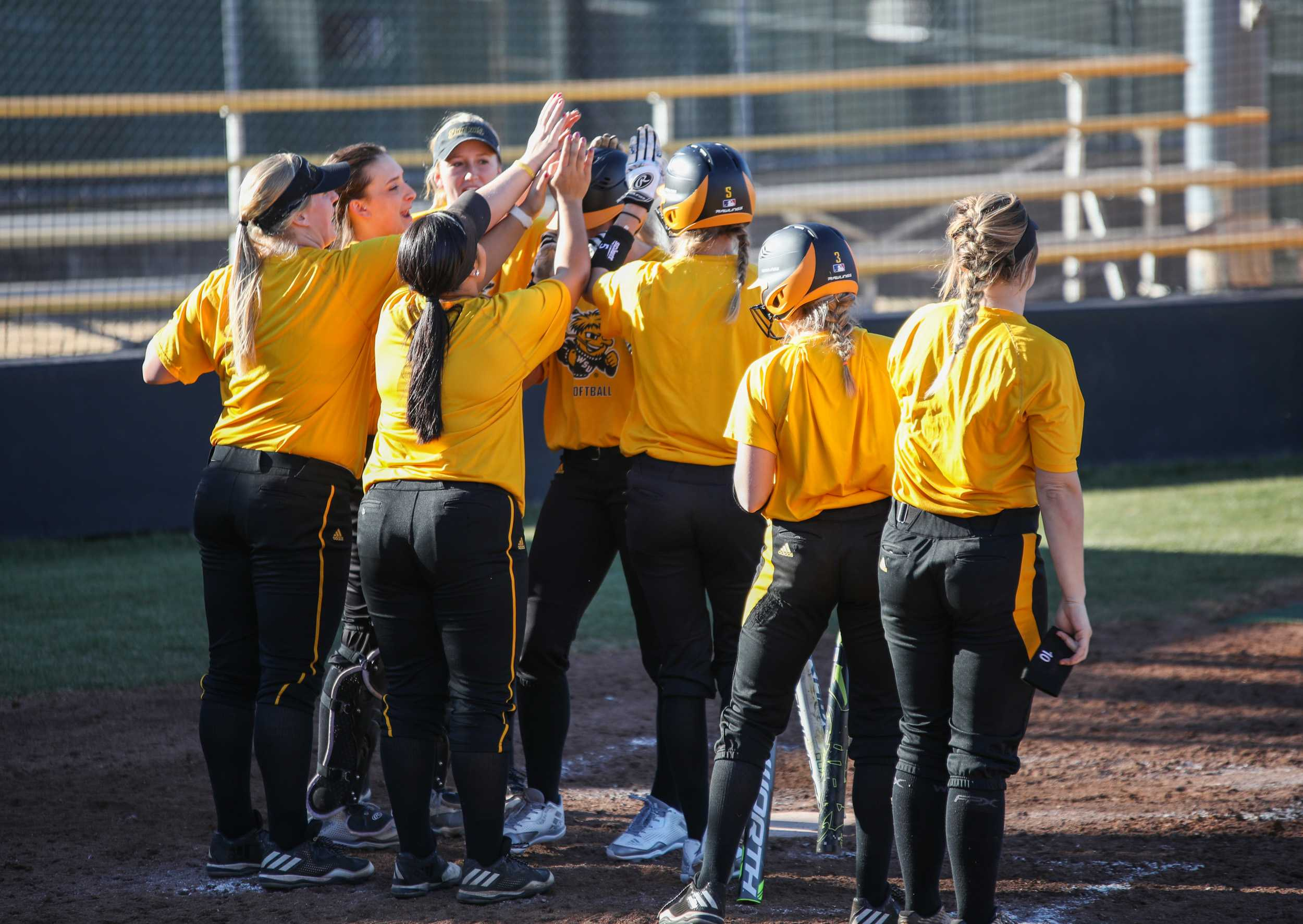 Ryleigh Buck is greeted by her teammates after hitting a home run in a scrimmage on Feb. 7, 2017.