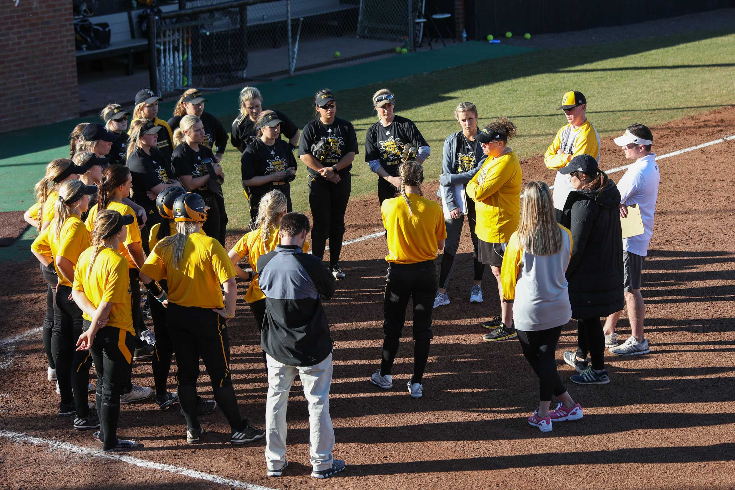 The Wichita State softball team meets together after practice Tuesday afternoon.