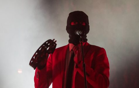 Twenty One Pilots lead singer Tyler Joseph plays tambourine and sings during the first song of the night in Intrust Bank Arena. The band and other opening acts stopped in Wichita for the Emotional Roadshow tour. (Feb. 3, 2017)