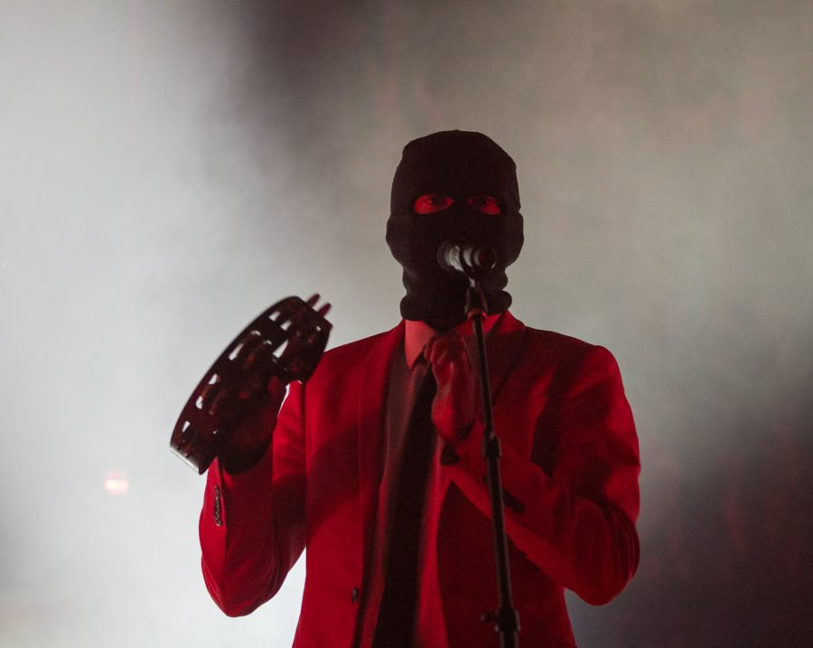 Twenty+One+Pilots+lead+singer+Tyler+Joseph+plays+tambourine+and+sings+during+the+first+song+of+the+night+in+Intrust+Bank+Arena.+The+band+and+other+opening+acts+stopped+in+Wichita+for+the+Emotional+Roadshow+tour.+%28Feb.+3%2C+2017%29