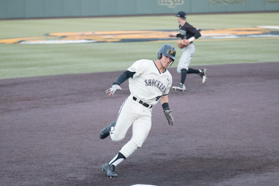 Wichita+State%27s+Jordan+Boyer+rounds+third+base+headed+to+home+to+score.+Boyer+had+two+RBI+during+the+game+against+Utah+Valley.+%28Feb.+17%2C+2017%29