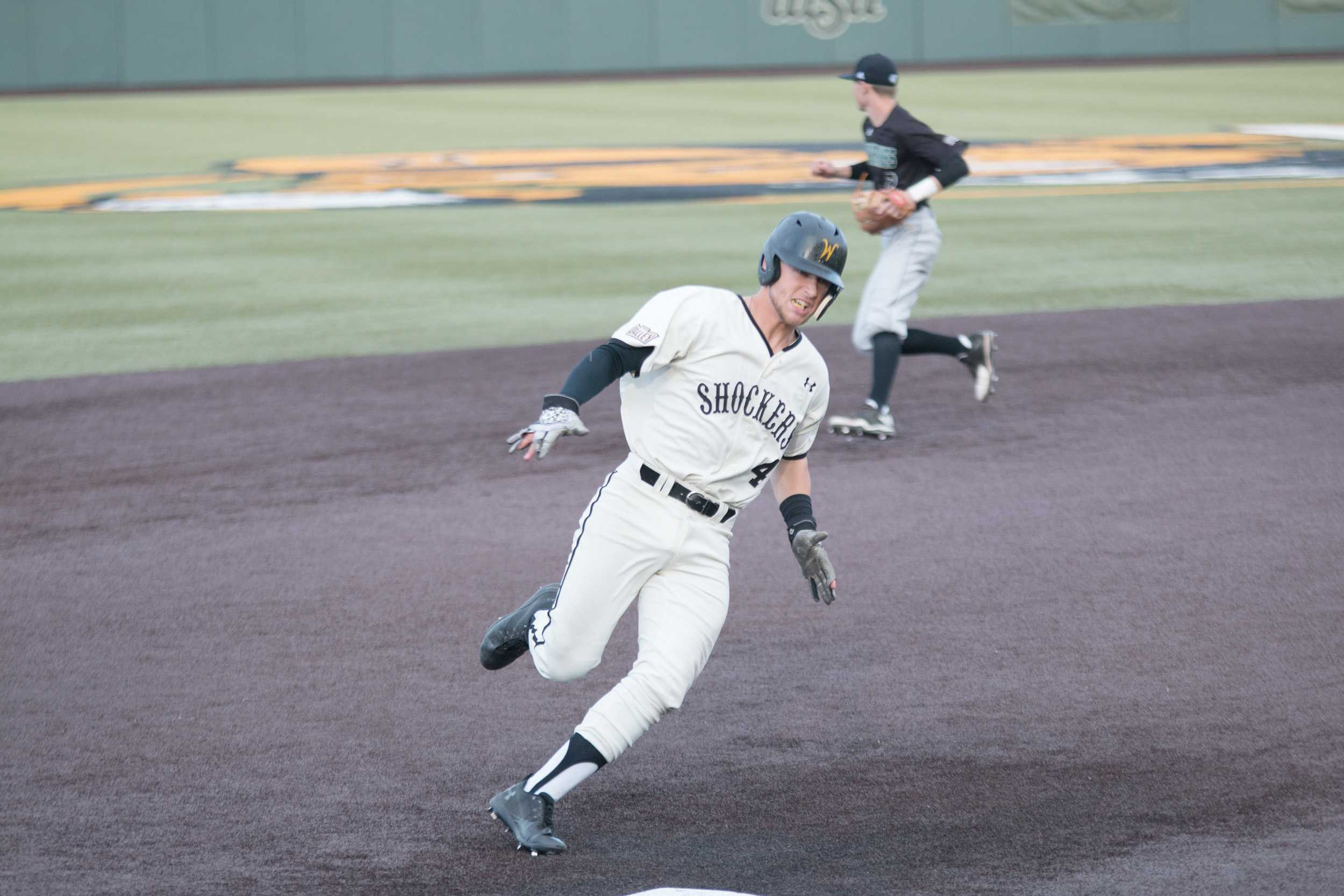Wichita State's Jordan Boyer rounds third base headed to home to score. Boyer had two RBI during the game against Utah Valley. (Feb. 17, 2017)