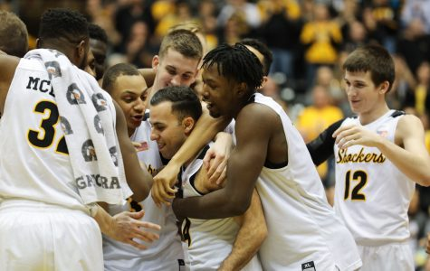 Wichita State guard John Robert Simon (14), center, is embraced by the team after the win against Evansville. Simon was honored as part of the senior night celebration. (Feb, 21, 2017)