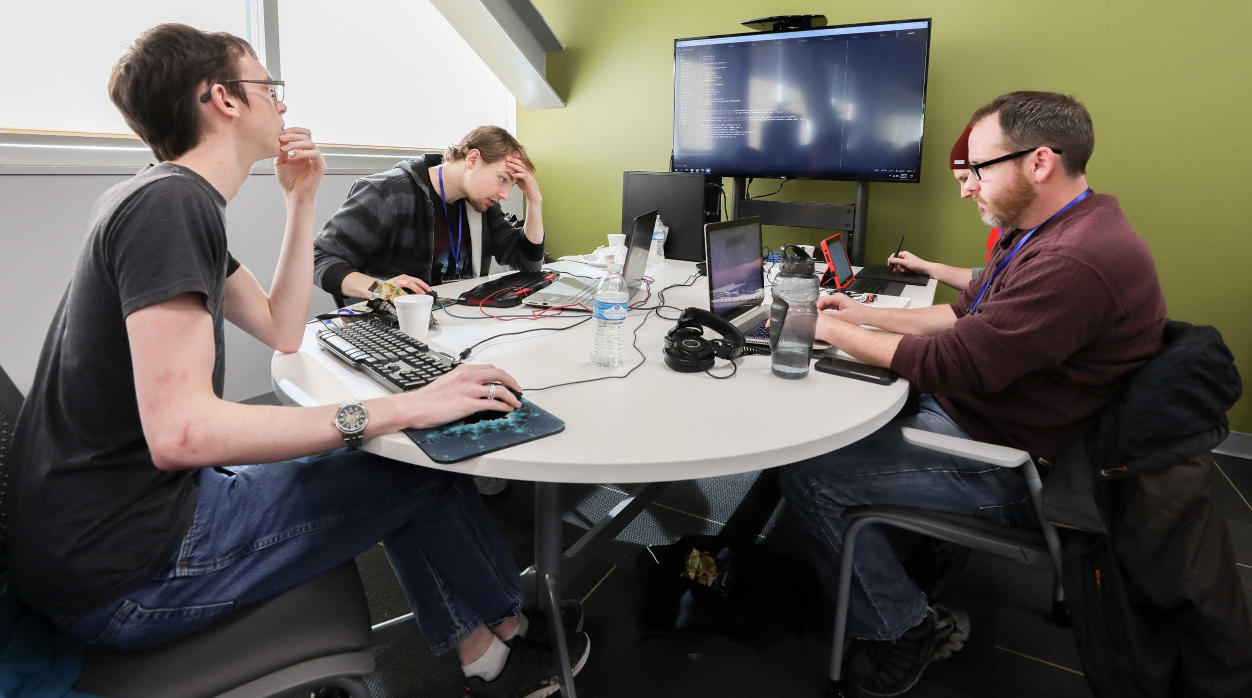 From left: Jesse Pritchard, Brandon Jones, Steven Reust and Nathan Branded work on coding a game from start to finish at the Wichita eSports Convention. The group was competing in the ICT Game Jam for a cash prize. (Feb. 5, 2017)