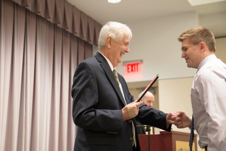 President+Bardo+presents+a+Wallace+Scholar+recipient+with+his+award.