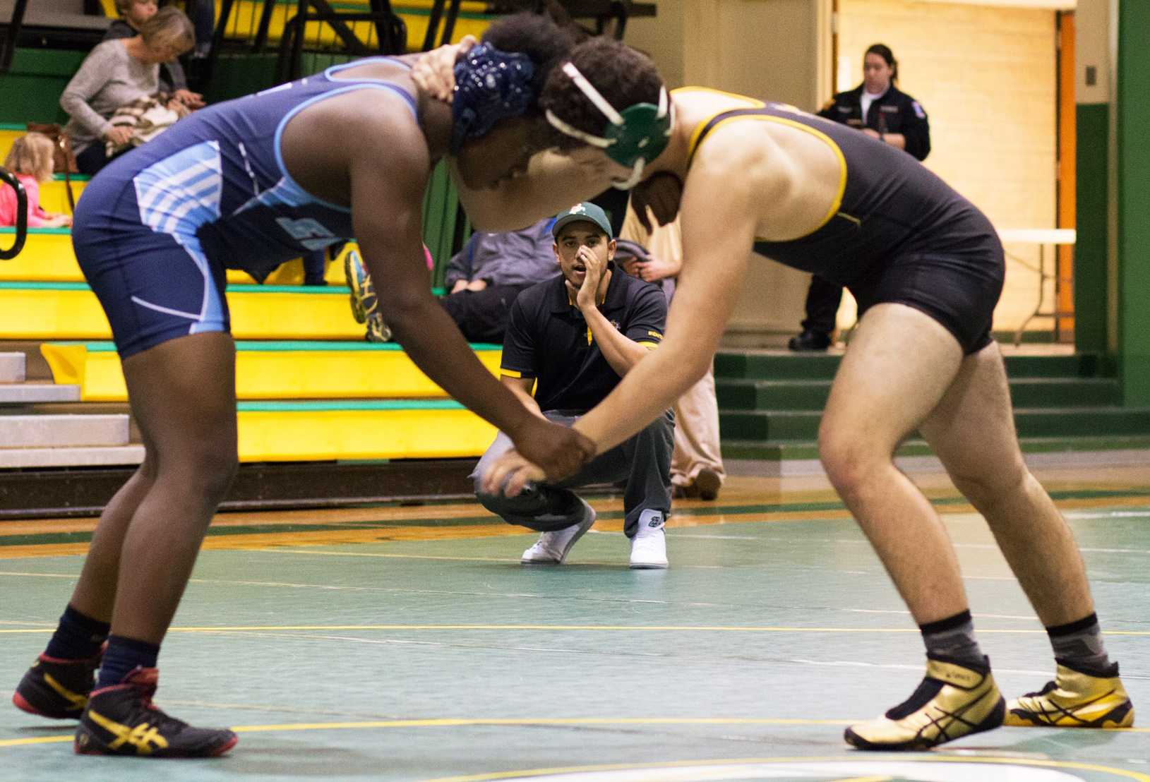 Dominic Davis, a freshman majoring in biology at Wichita State, coaches a wrestler from the side of the mat at Bishop Carrol High School. (Feb. 1, 2017)