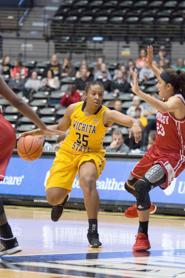 Wichita State forward Rangie Bessard moves past Bradley defenders in an attempt to score.
