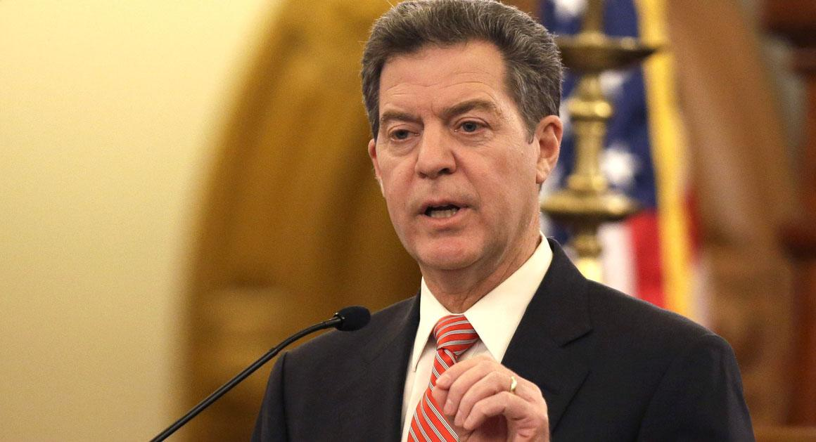 Gov. Sam Brownback delivers his State of the State address at the Kansas Statehouse in Topeka, Kan., Thursday, Jan. 15, 2015. (AP Photo/Orlin Wagner)