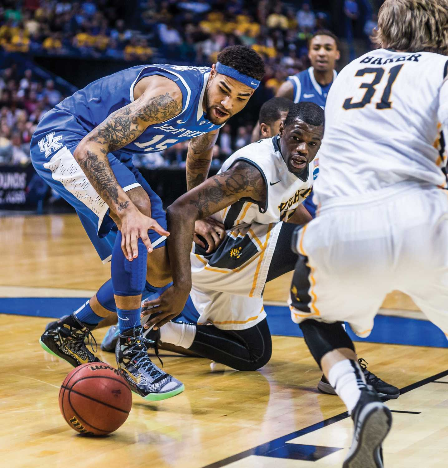 Senior Chadrack Lufile goes after the loose ball during the Wichita State vs Kentucky game Sunday evening inside the Scottrade Center Arena in St. Louis for the Round of 32 of the NCAA Tournament. The Shockers failed to beat the Wildcats and lost 78-76.