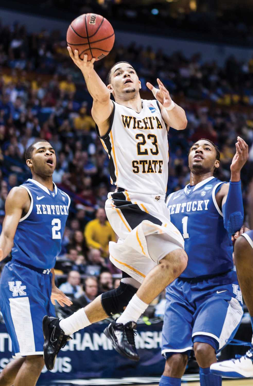 Former Shocker Fred VanVleet soars through the air during the Wichita State vs Kentucky game.