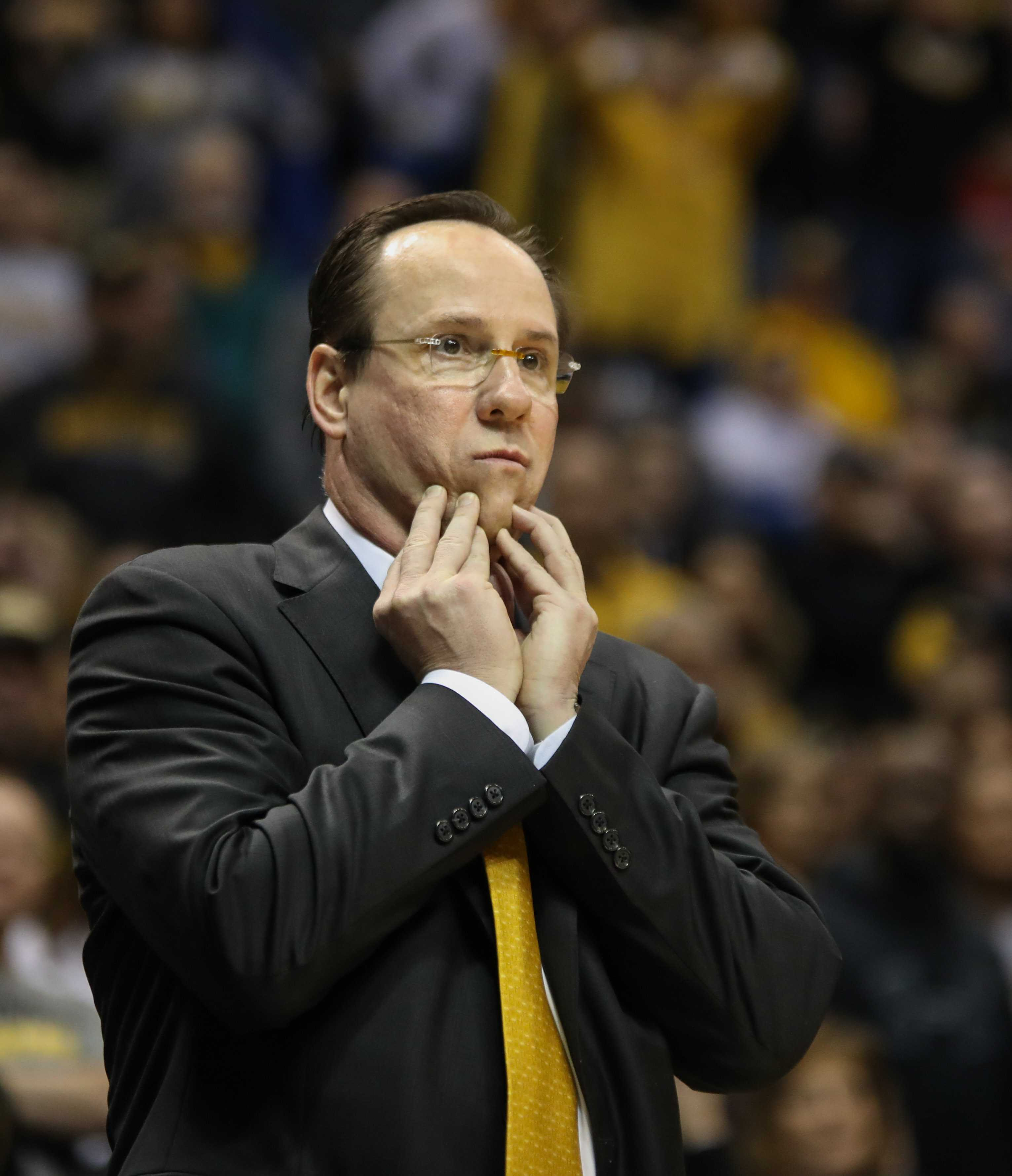 Coach Gregg Marshall looks worriedly toward his team early in the game.