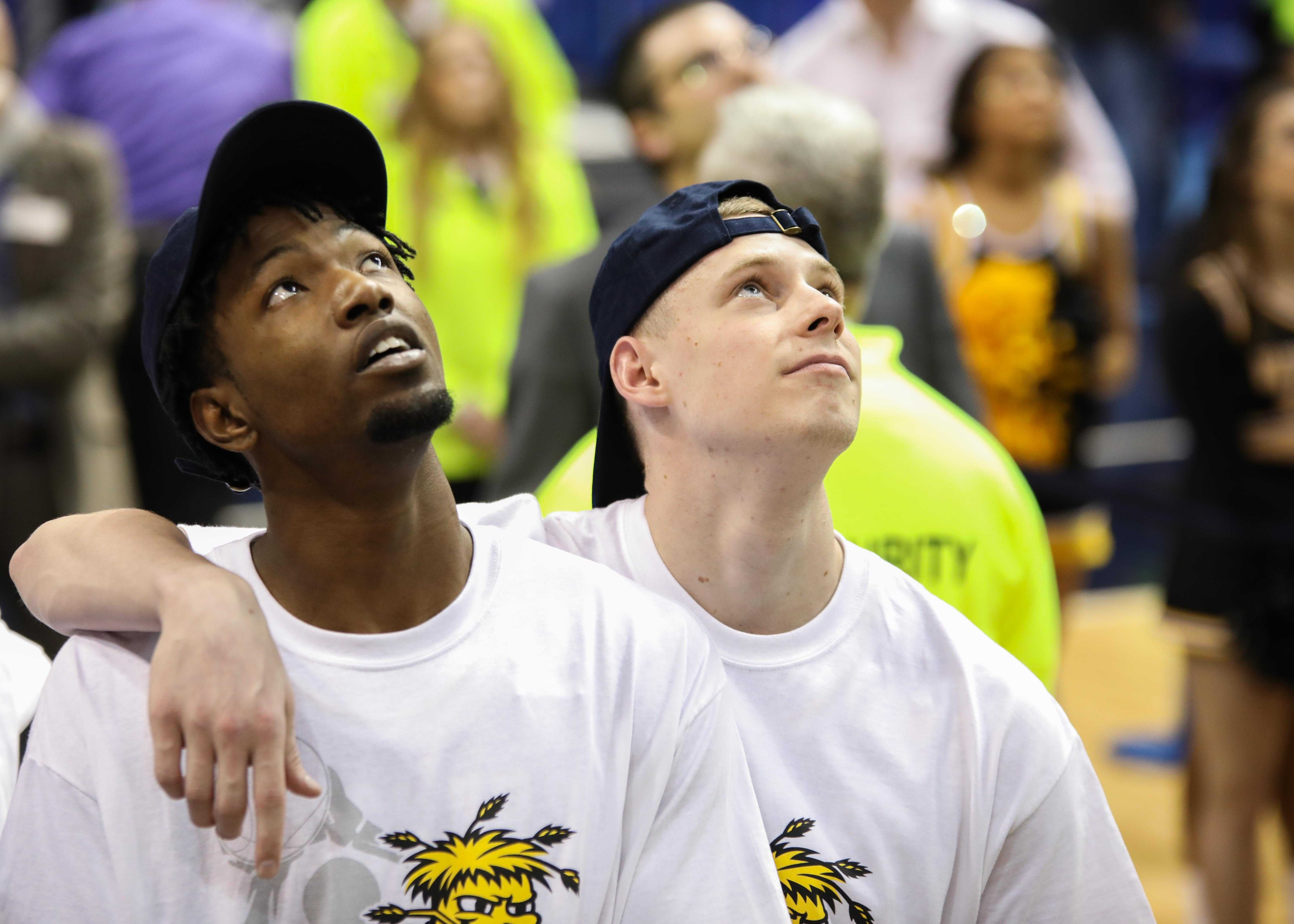 Zach Brown (left) and Zach Bush watch the One Shining Moment video. Senior Bush appeared to tear up.