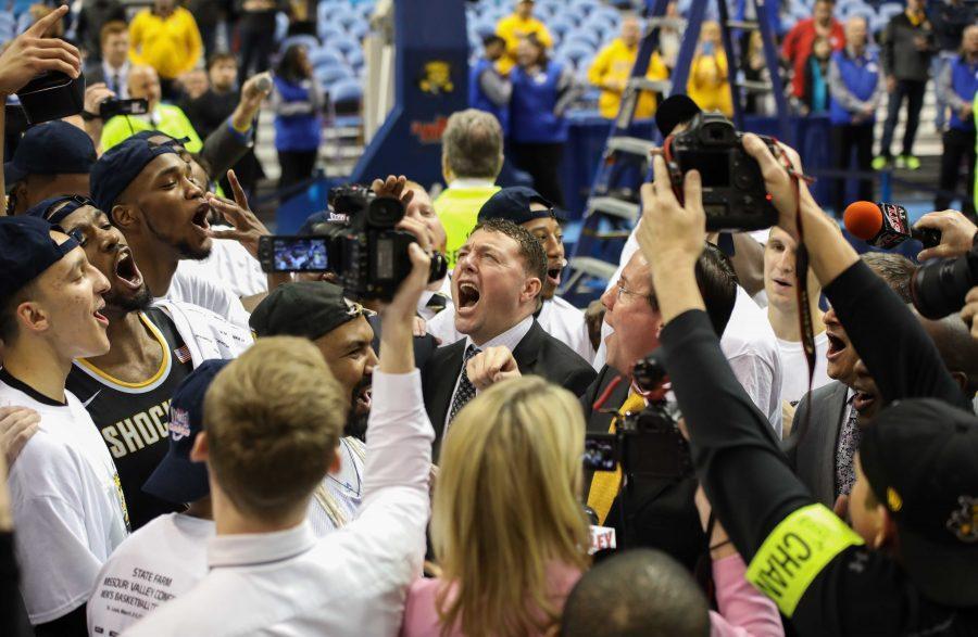 The Shockers, led by coach Marshall, celebrate their win by teaching the crowd their chant. (March 5, 2017)