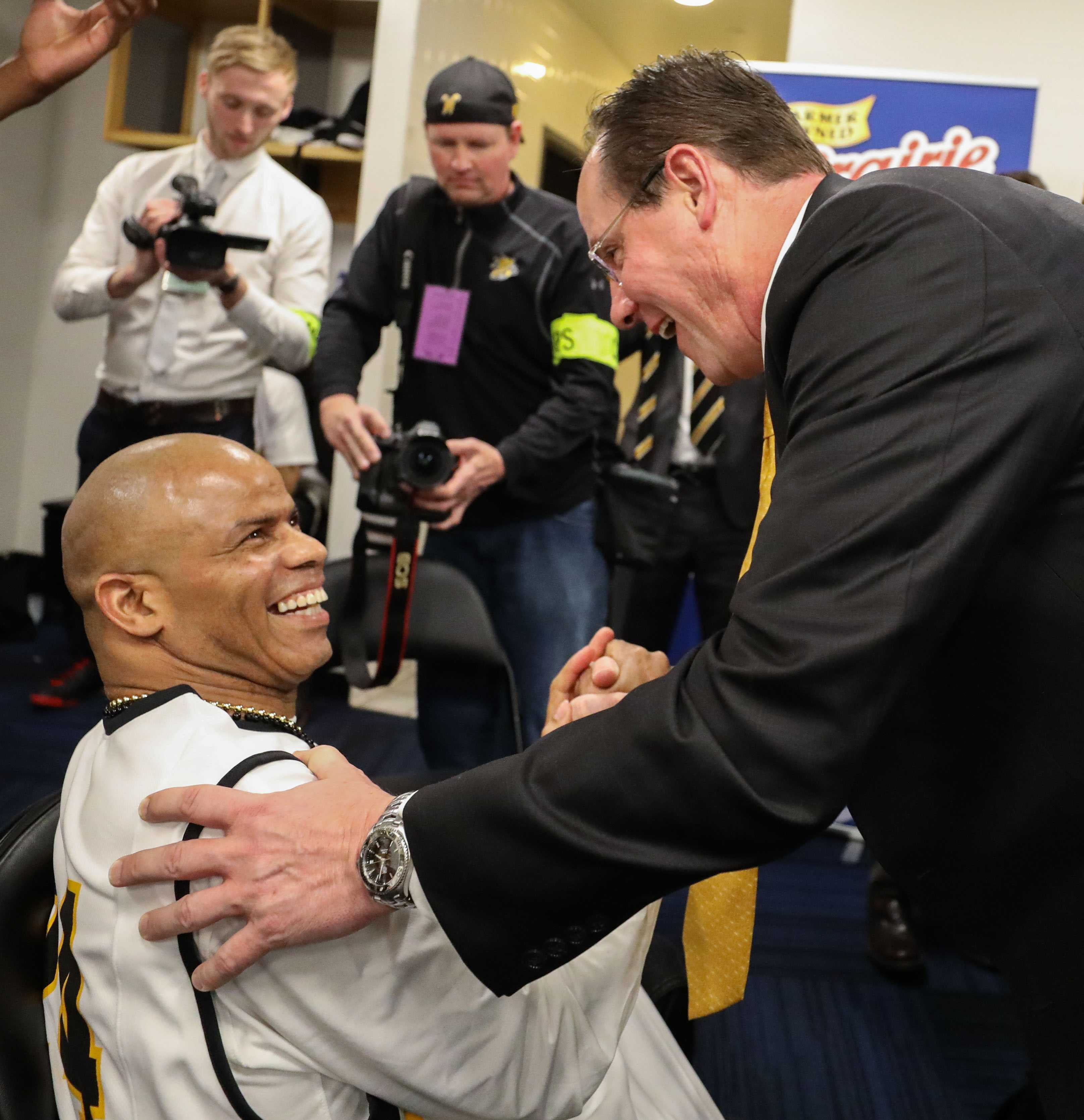 Gregg Marshall greets Darren Thomas, a die-hard Shockers fan, in the locker room after the championship game in St. Louis.