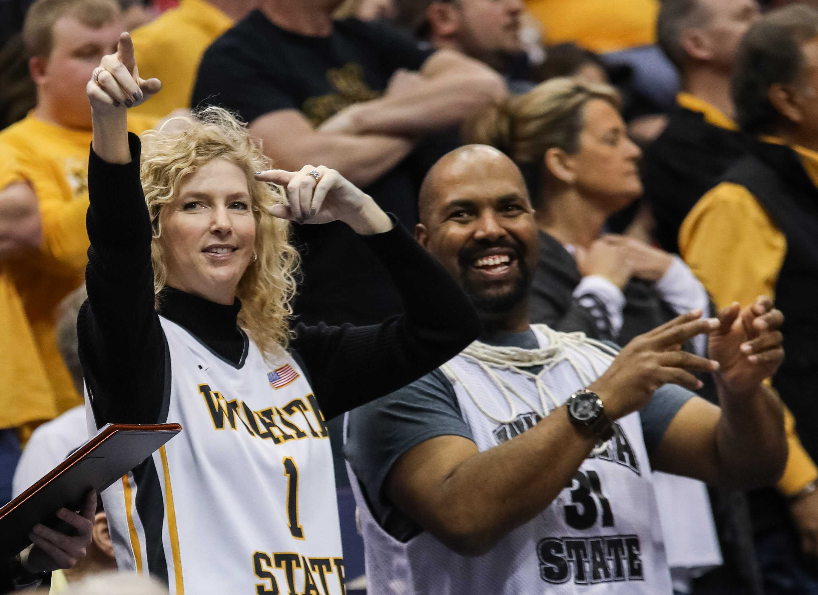Head coach Gregg Marshall's wife Lynn points to the cheerleaders and pep  band during a cheer after the Shockers 82-56 victory over Bradley.