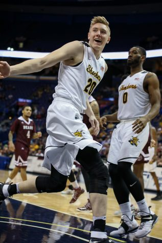 Wichita State center Rauno Nurger (20) grins after driving to the basket.