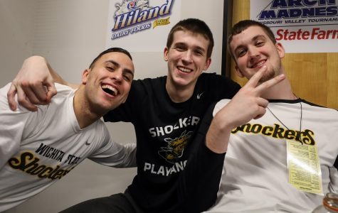 Wichita State's John Robert Simon (14), Austin Reaves (12) and Brett Barney (4) pose for a photo in the locker room.