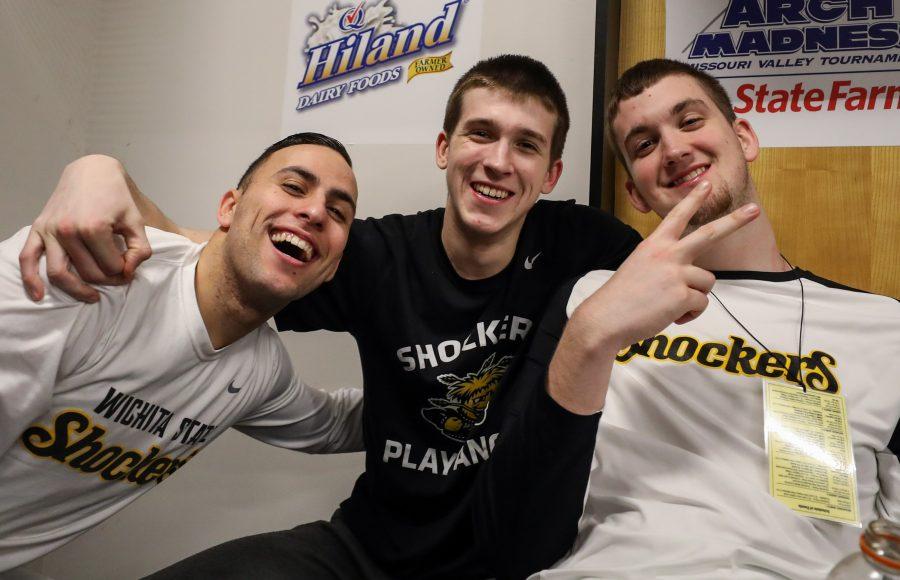 Wichita State's John Robert Simon (14), Austin Reaves (12) and Brett Barney (4) pose for a photo in the locker room.