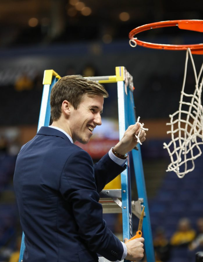 Kellen+Marshall+holds+up+his+piece+of+the+Missouri+Valley+Conference+Tournament+Championship+net.+Kellen+is+Gregg+Marshall%27s+son%2C+and+the+head+manager+for+the+men%27s+basketball+team.