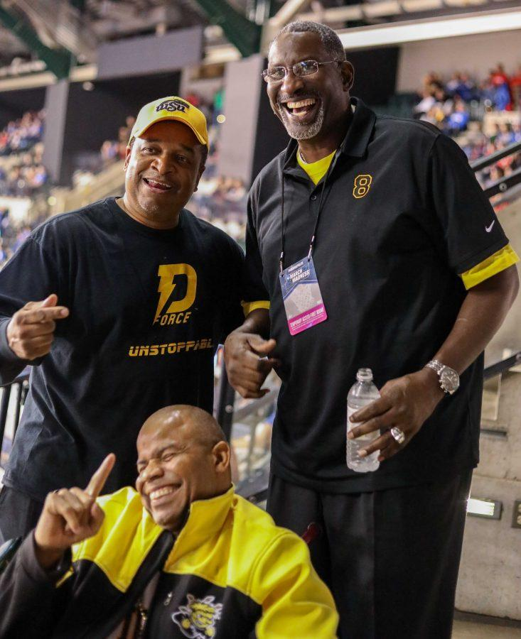 Wichita State fans Darren Thomas (bottom) and William Polite (left) take a photo with Wichita State and NBA player Cliff Levingston in Bankers Life Fieldhouse on March 17, 2017.