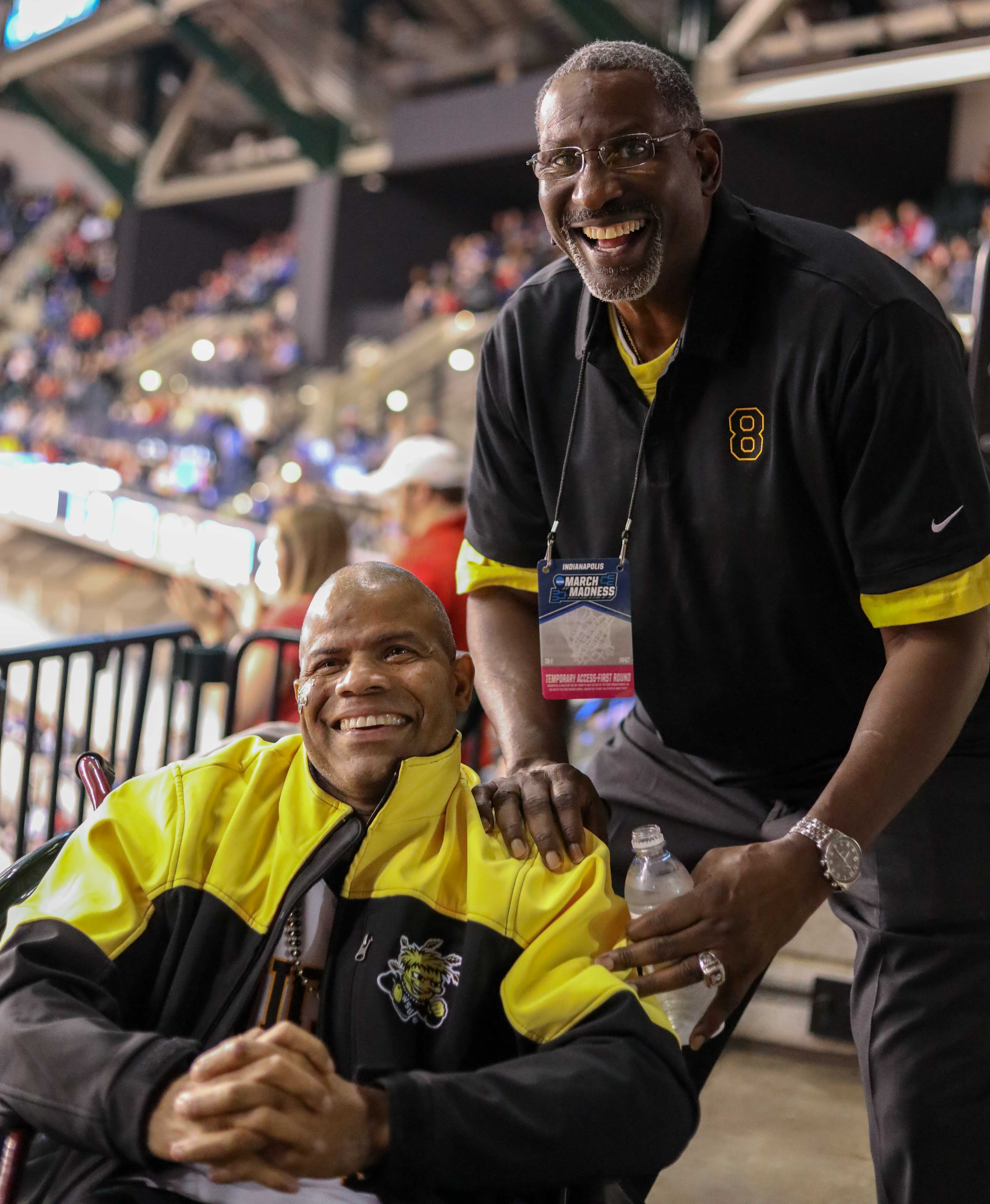Cliff Levingston poses for a photo with long time fan Darren Thomas. Levingston played basketball for Wichita State from 1979-1982  before being drafted by the Detroit Pistons in 1982.