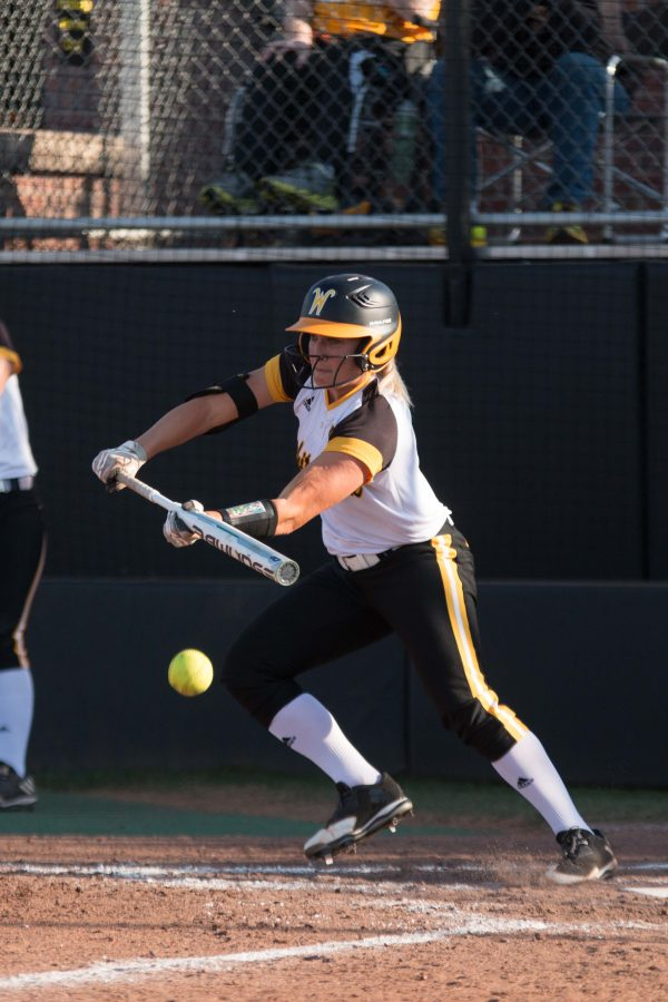 Junior+McKenzie+Adams+bunts+the+ball+against+Nebraska.+Wichita+State+overcame+a+5-1+deficit+by+scoring+five+runs+in+the+sixth+inning+to+win+7-5.+
