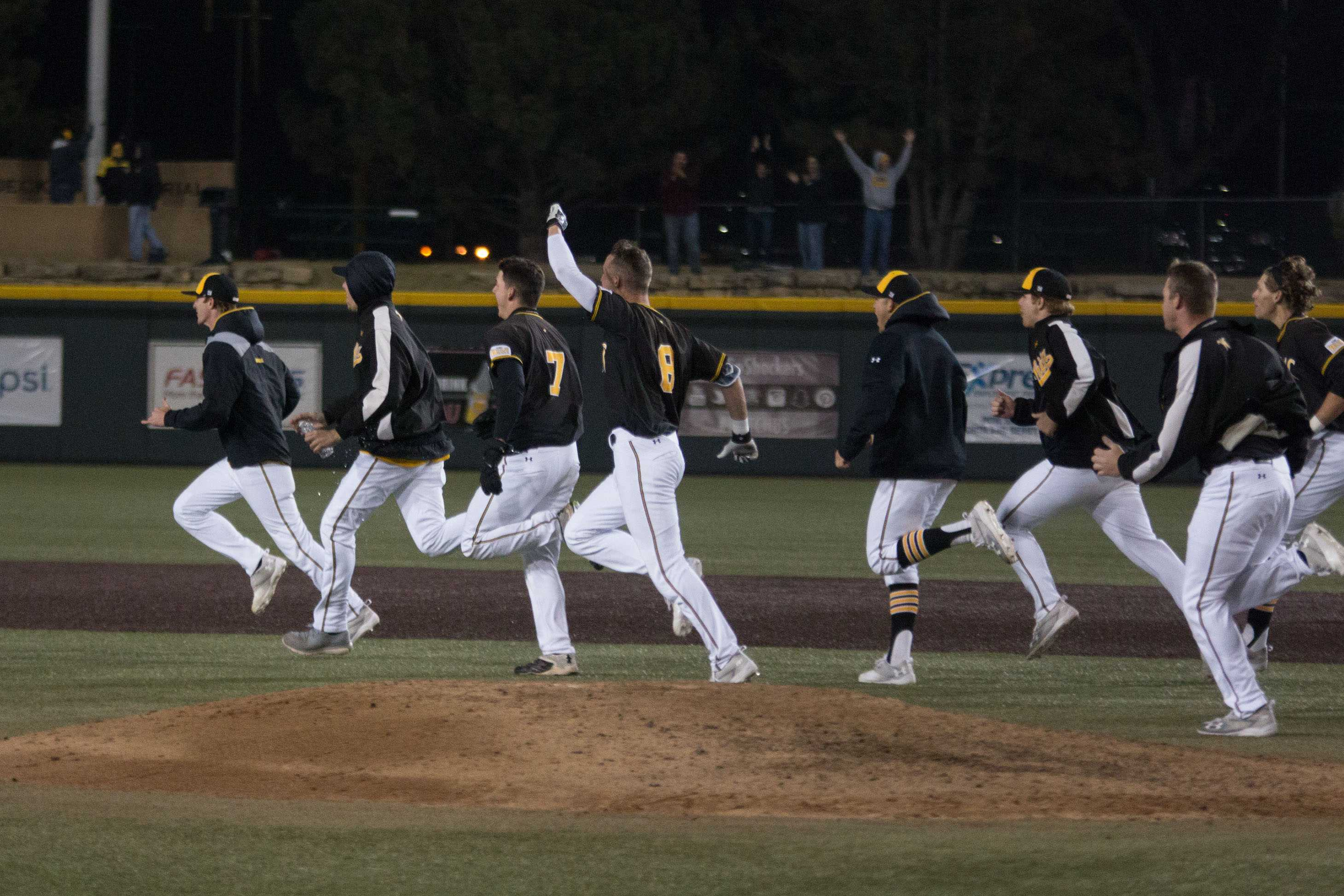 Shockers rush out onto the field to celebrate their victory against Valparaiso Friday evening.