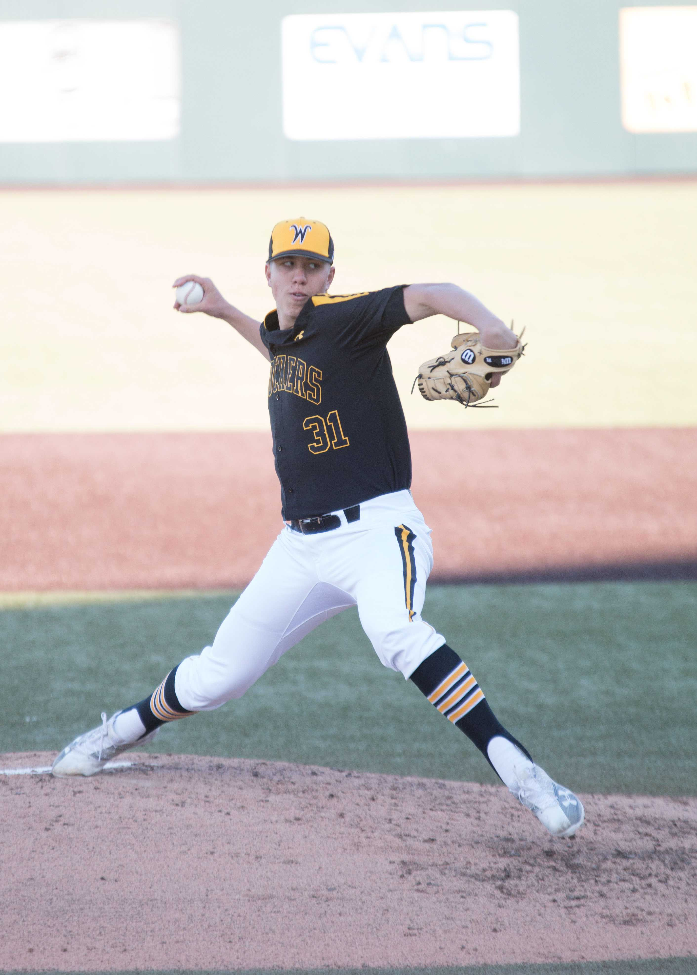 Sophomore Connor Lungwitz winds up a pitch against the Mavericks. Shockers won the game against Omaha with a score of 8-0, making this their seventh consecutive win this season.