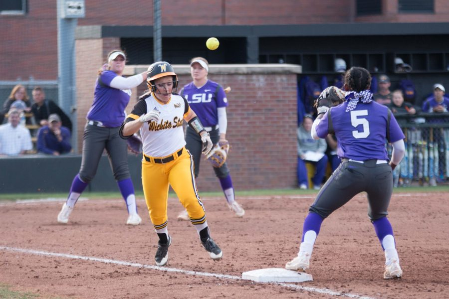 Junior+McKenzie+Adams+races+to+first+base+during+the+game+against+Louisiana+State.+