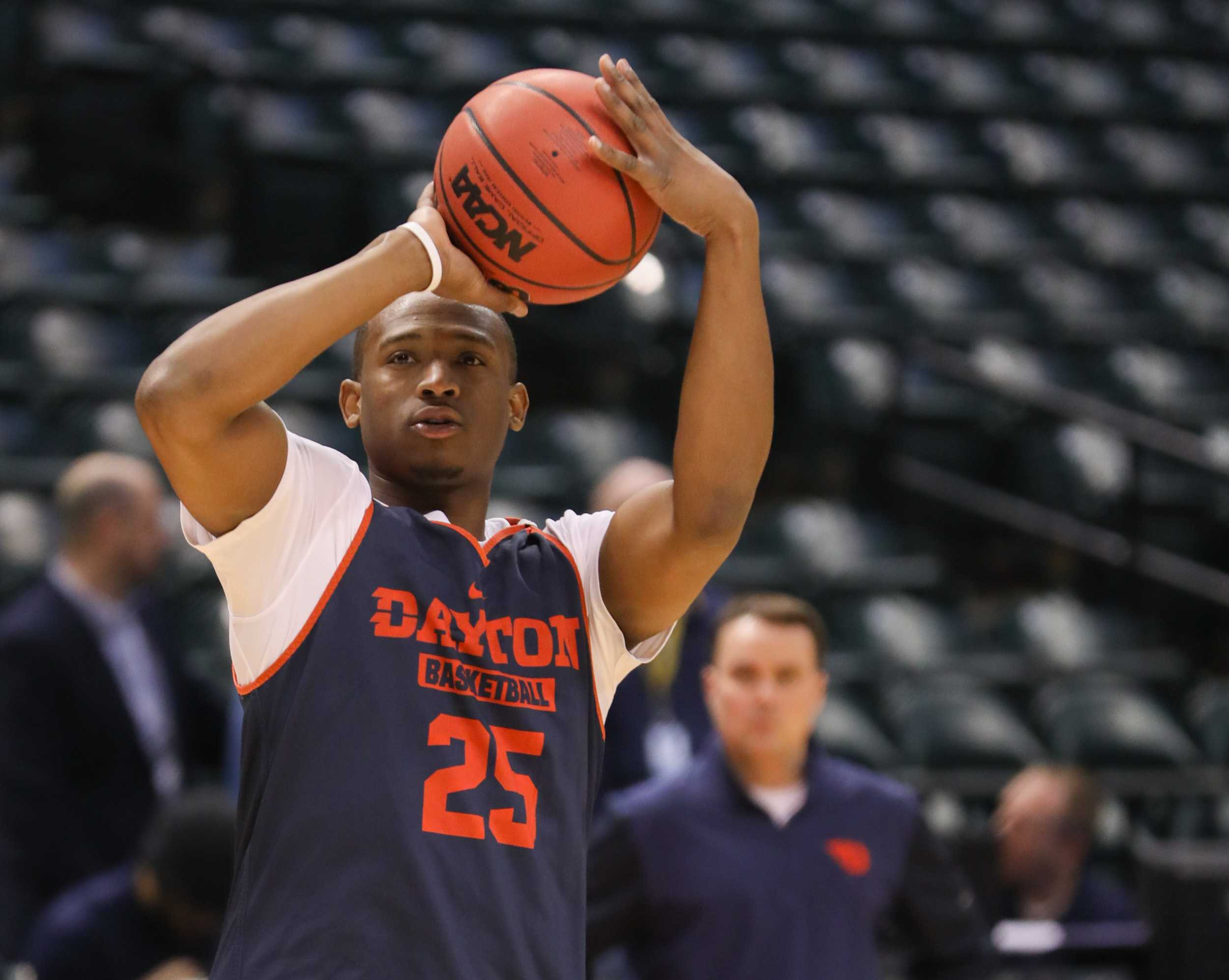 Dayton's Kendall Pollard practices shooting threes at the open practice in Bankers Life Fieldhouse before facing Wichita State University Shockers on Friday. (Mar. 16, 2017)