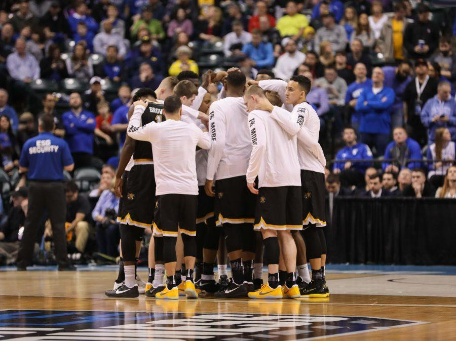 Wichita State huddles on the court right before tipoff of the game against the Kentucky Wildcats in the second round of the NCAA Tournament in Indianapolis. (Mar. 19, 2017)