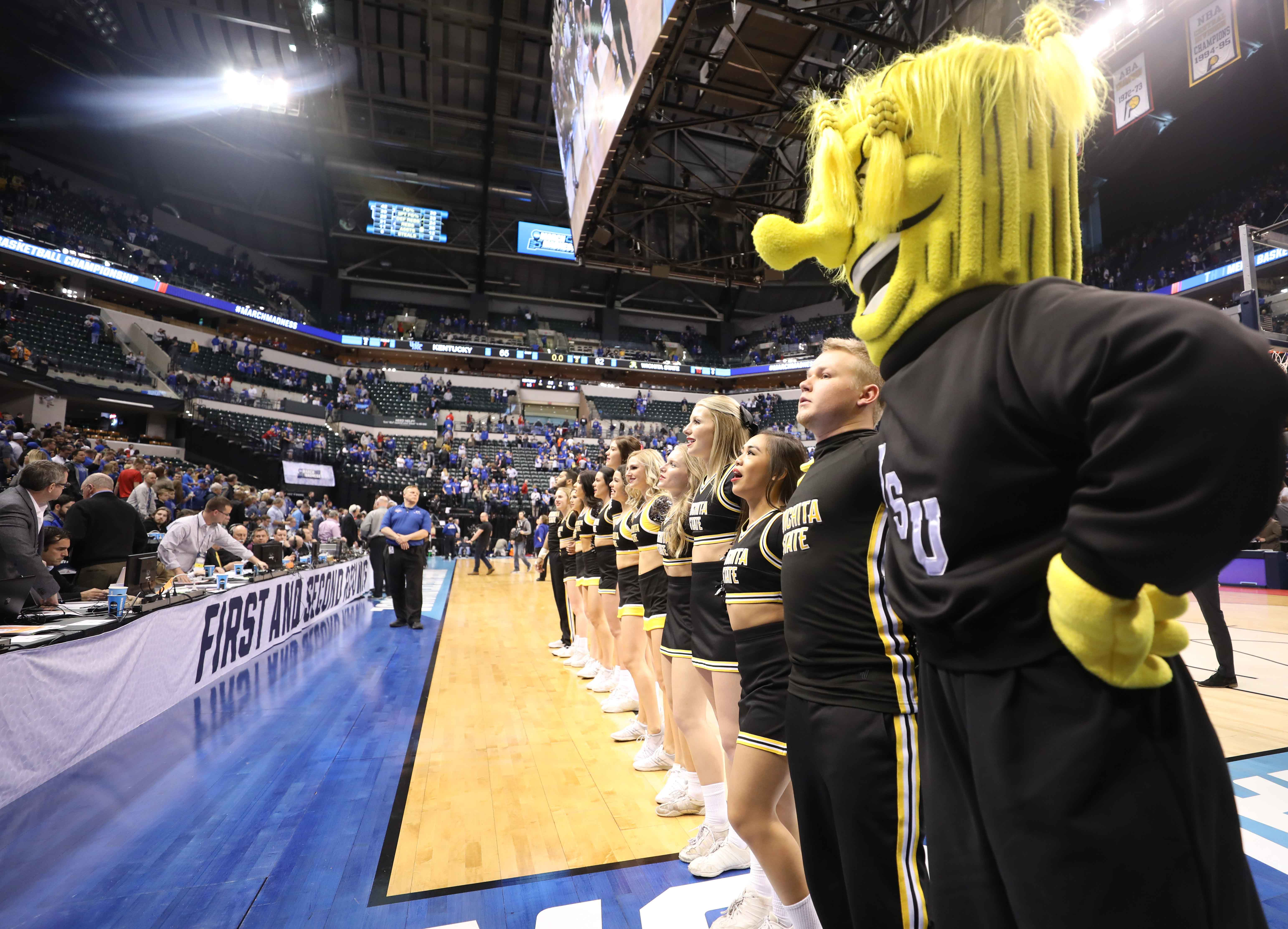 Wichita State cheer and dance team sing the alma mater in front of the fan section in Bankers Life Fieldhouse after the Shockers lost to Kentucky 65 – 62.  (Mar. 19, 2017)
