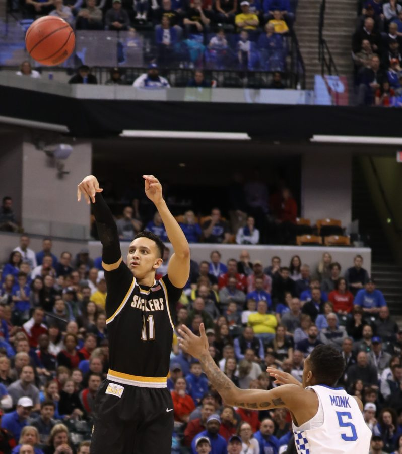 Wichita State guard Landry Shamet shoots a three pointer over Kentucky guard Malik Monk in the first half of the second round of the NCAA Tournament in Indianapolis. (Mar. 19, 2017)
