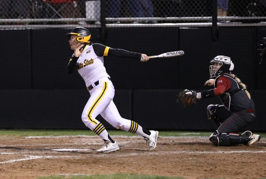 Wichita State junior Mackenzie Wright (10) watches after a hit Wednesday afternoon against Oklahoma. (Mar. 1, 2017)