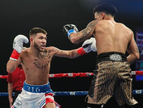 Nico Hernandez throws a left hook against Pat Gutierrez during the first round at Kansas Star Arena in Mulvane.  (Mar. 25, 2017)