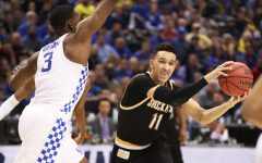 Wichita State's Landry Shamet (11) fakes a pass before shooting over Kentucky forward Bam Adebayo (3).