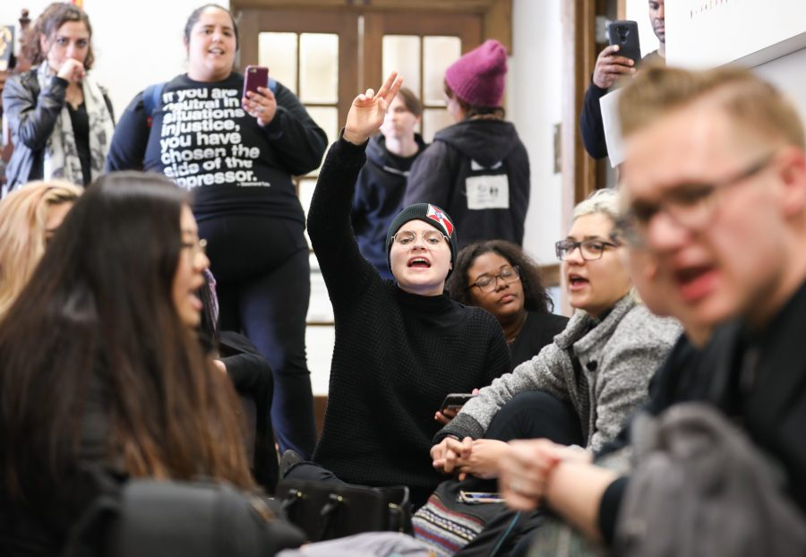 Sandra Carlo, freshman, conducts chants at the sit in outside of university president John Bardo's office on Tuesday afternoon. The same group introduced a resolution Wednesday calling for a vote of no confidence and the resignation of WSU President John Bardo. (Mar. 14, 2017)