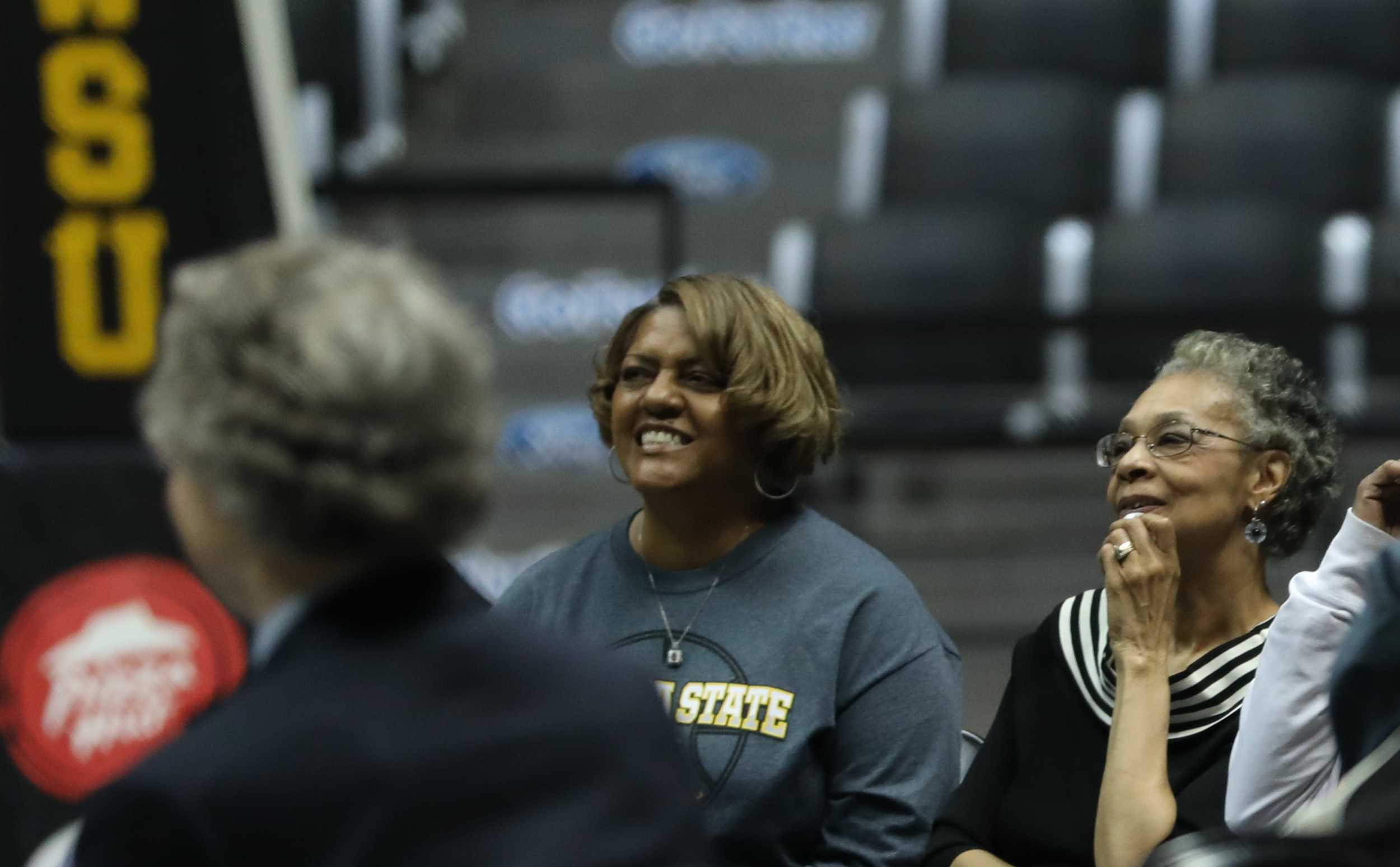 Gloria Stallworth, right, watches as friends and teammates of her late husband share their memories of him during the memorial serve in Koch Arena. (Mar. 24, 2017)