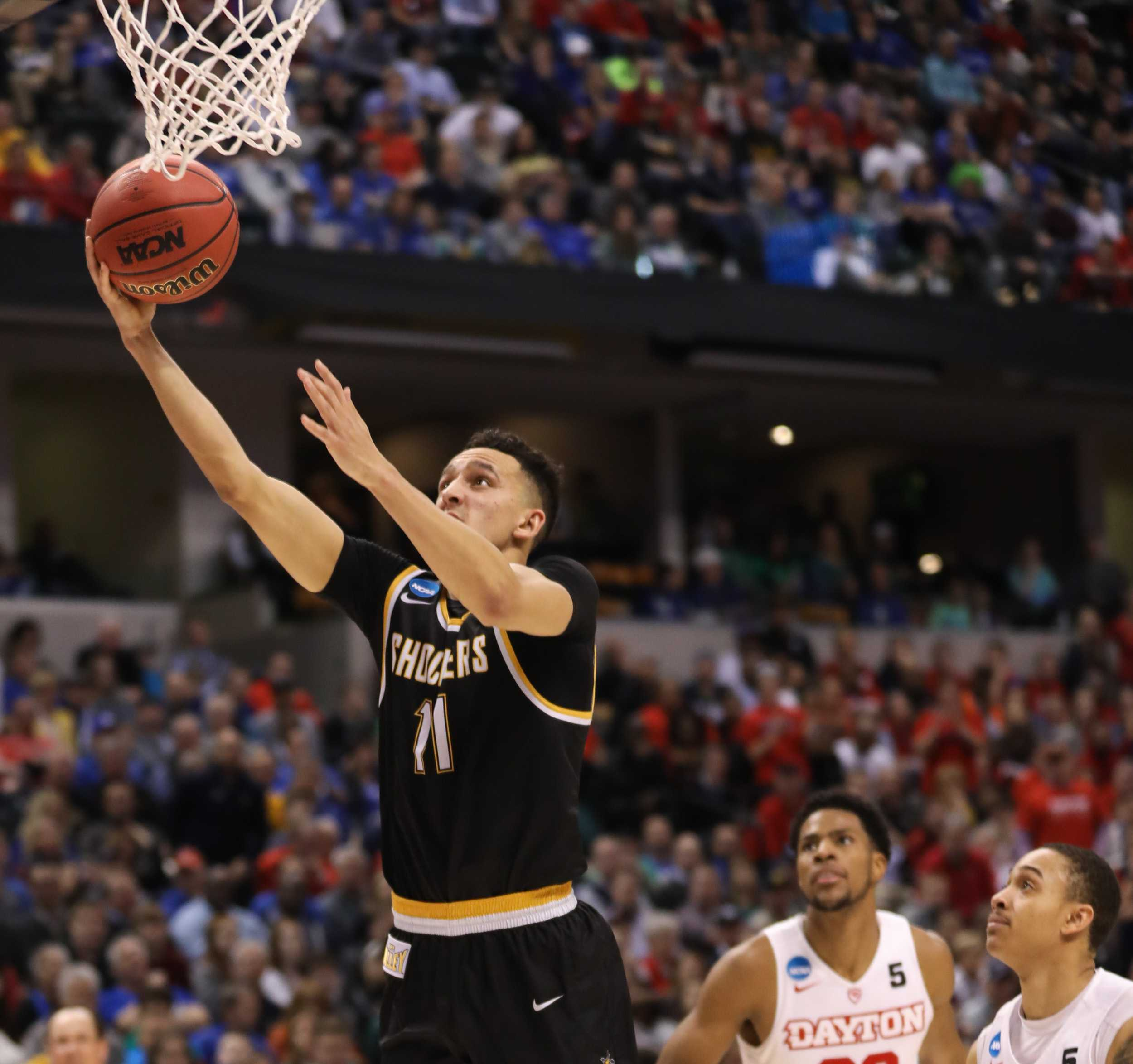 Wichita State's Landry Shamet attempts a layup against Dayton in the second half at Bankers Life Fieldhouse in Indianapolis. The Shockers beat the Flyers 64 – 58 (Mar. 17, 17, 2017)