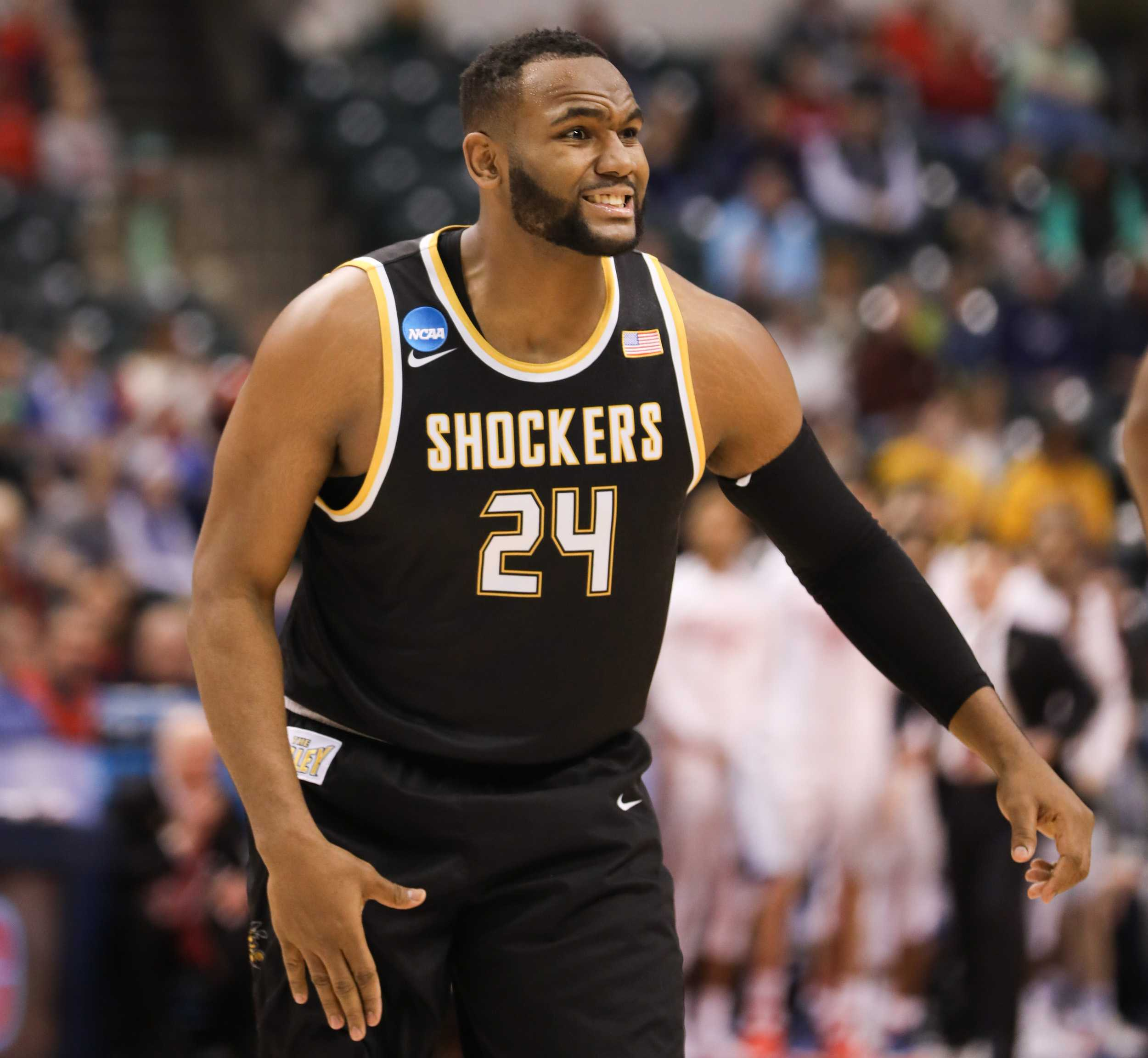 Wichita State's Shaquille Morris tries to explain how he was fouled in the first half against Dayton at Bankers Life Fieldhouse in Indianapolis. (Mar. 17, 17, 2017)