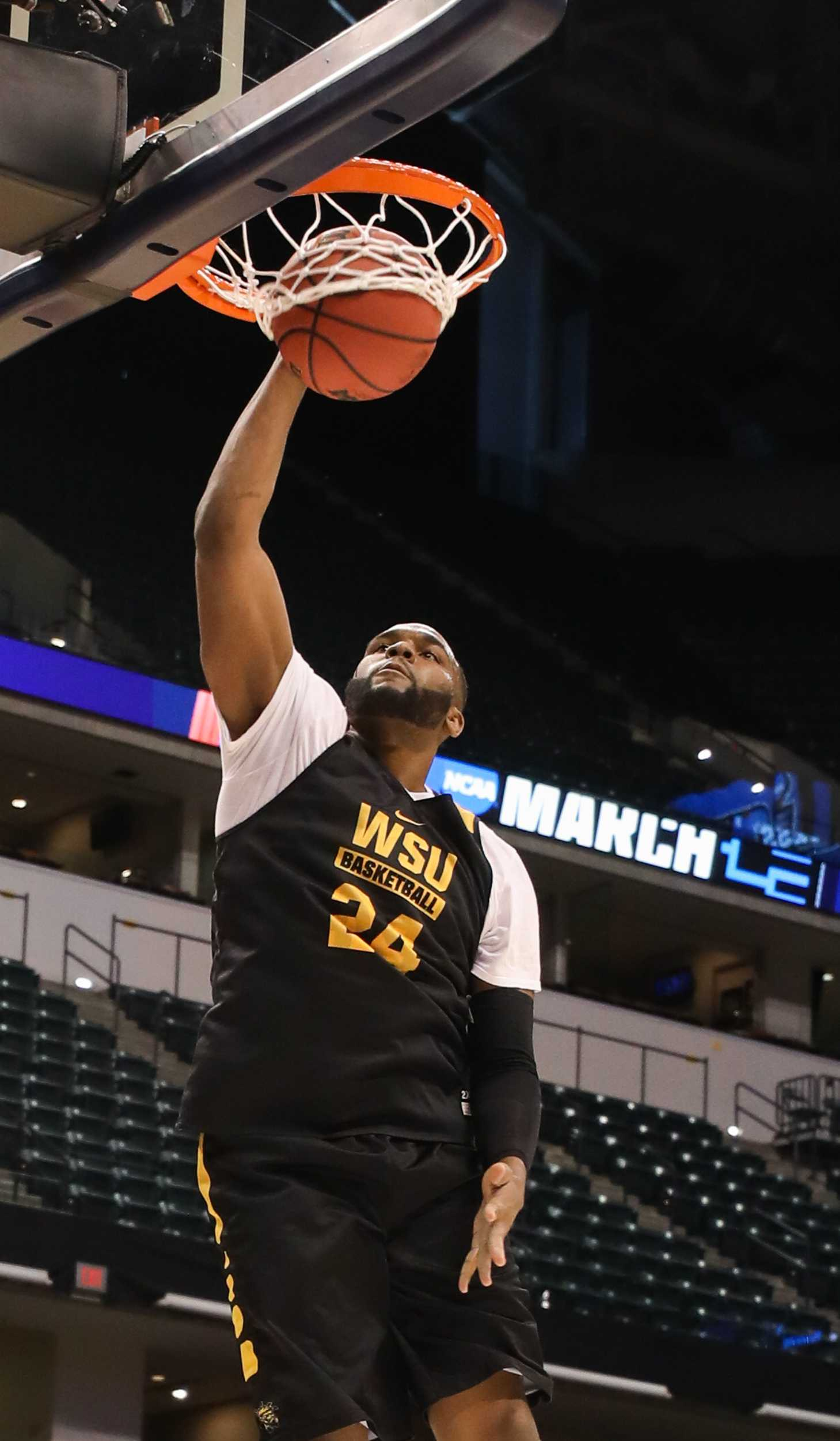 Wichita State center Shaquille Morris dunks during open practice on Thursday afternoon in Bankers Life Fieldhouse in Indianapolis. (Mar. 16, 2017)
