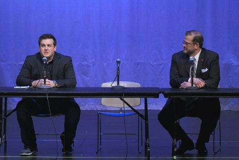 Jordan Husted, campaign manager for Libertarian Chris Rockhold, and Democrat James Thompson participate in a forum for the 4th District Special Election candidates Wednesday in the CAC Theatre. The empty chair between them was for Republican Ron Estes, who did not attend the forum and did not send anyone in his stead.