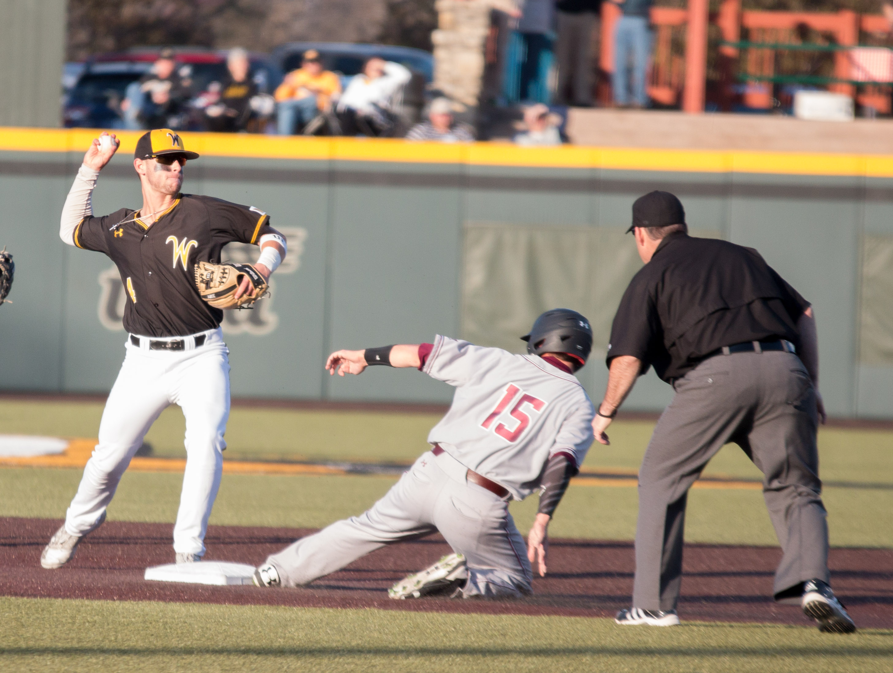 Redshirt Sophomore Jordan Boyer throws to first base after tagging a Southern Illinois player.