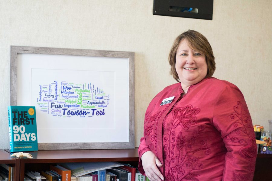 Teri Hall, Vice President of Student Affairs, poses with her Towson University Wordle.