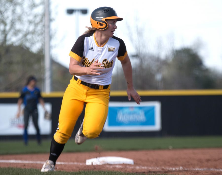 Junior Mackenzie Wright rounds third base on her way to home to score against Indiana State.